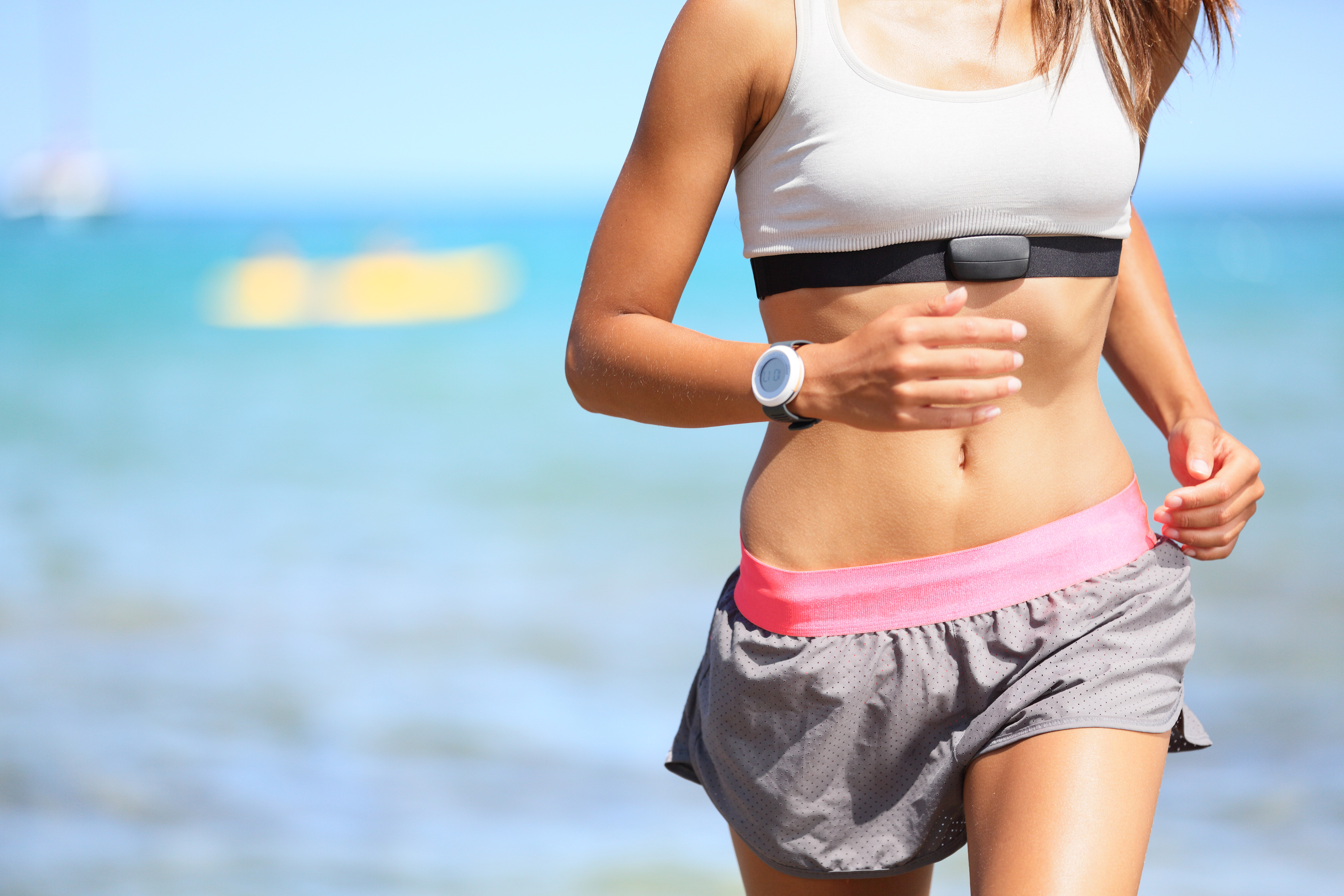 bigstock-Runner-woman-with-heart-rate-m-468598122